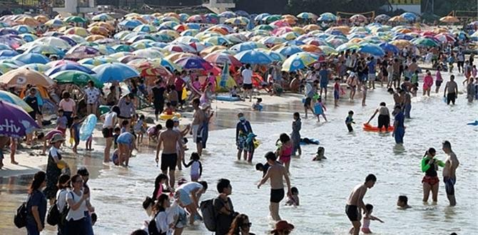 Koronavirüs Dünyayı kasıp kavururken Hong Kong'da halk plaja akın etti!
